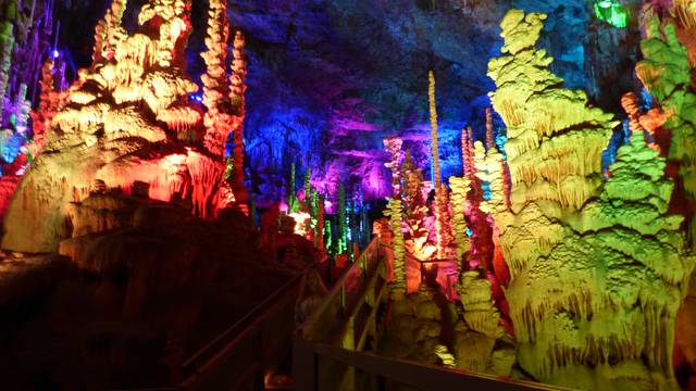 The illuminated Aven Armand cave on the Causse Méjean plateau